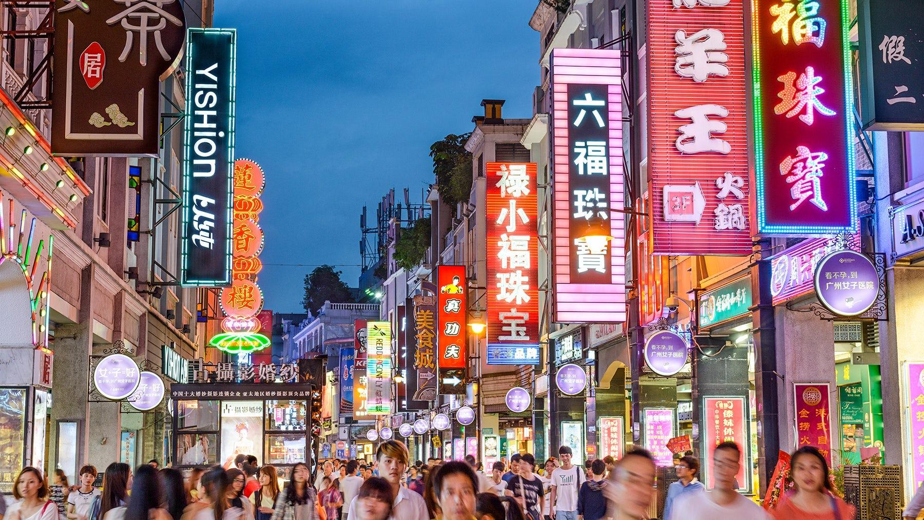 Shoppers on Shangxiajiu Pedestrian Street, a shopping district in Guangzhou, China. Shutterstock.