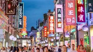 Shoppers on Shangxiajiu Pedestrian Street, a shopping district in Guangzhou, China. Shutterstock