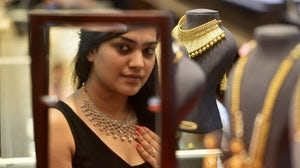 A woman buying jewellery on the occasion of Akshaya Tritiya at Kalyan Jewellers in Mumbai, India. Getty Images.