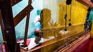 A female weaver works in a Tamil Nadu factory. Shutterstock