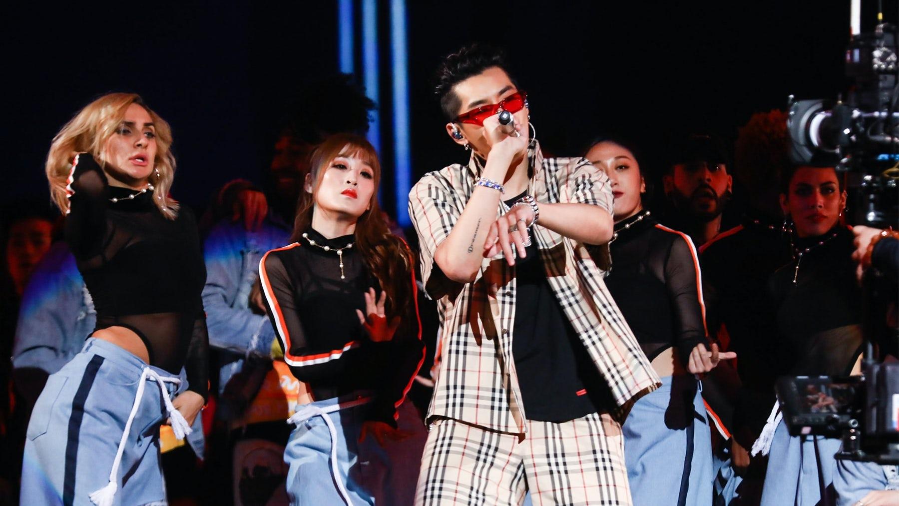 Singer Kris Wu performing on stage. Shutterstock.