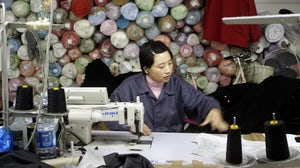 A Chinese textile worker in Prato, Italy. Getty Images.