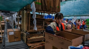 Employees pack boxes in a Cainiao warehouse  in Wuxi, China's eastern Jiangsu province, ahead of Singles' Day 2020. Getty Images.