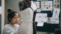 Fashion intern working on a design. Getty Images.