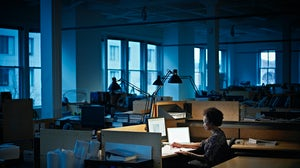 Employee Working Late. Getty Images.
