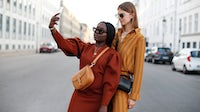 Influencers Lois Opoku and Jacqueline Zelwis during Copenhagen Fashion Week. Getty Images.