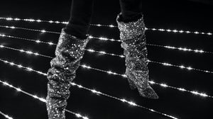 Saint Laurent boots being auctioned in FHCM's benefit for Sidaction. Courtesy.