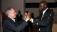 Louis Vuitton chief executive Michael Burke and Virgil Abloh attend a Louis Vuitton Parfum dinner two weeks before LVMH announced its acquisition of the Off-White trademark. Getty Images.