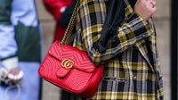 A woman wears a red quilted Gucci bag in Paris | Source: Getty Images