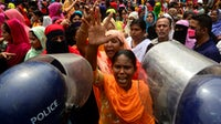 Garment workers protest in Dhaka, Bangladesh in March to demand wages due. Mamunur Rashid/NurPhoto via Getty Images.