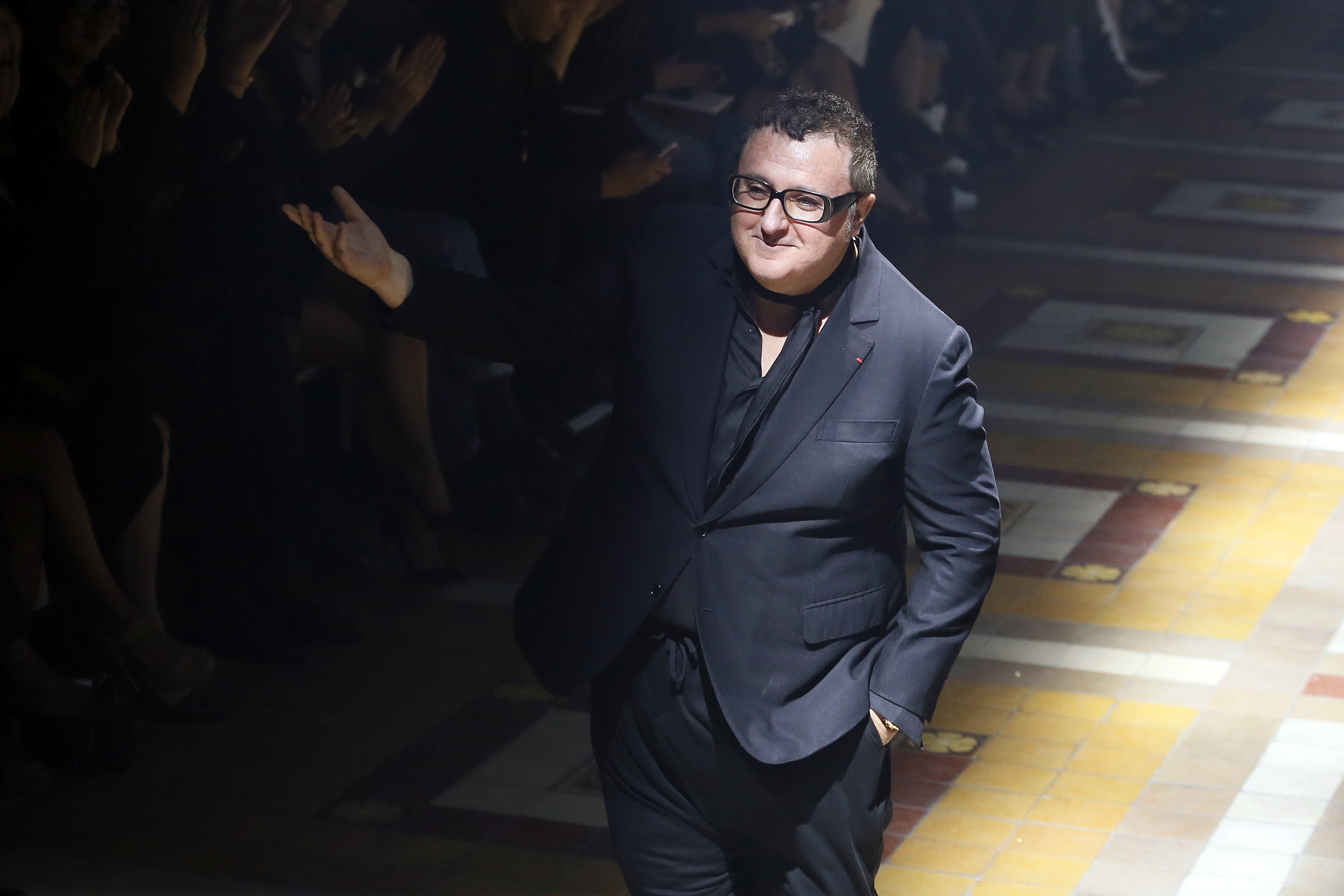 Alber Elbaz at the end of the Lanvin\'s 2015 Spring/Summer fashion show. Getty Images.