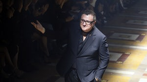 Alber Elbaz acknowledges the audience at the end of the Lanvin 2015 Spring/Summer ready-to-wear collection fashion show. Patrick Kovarik/AFP via Getty Images.