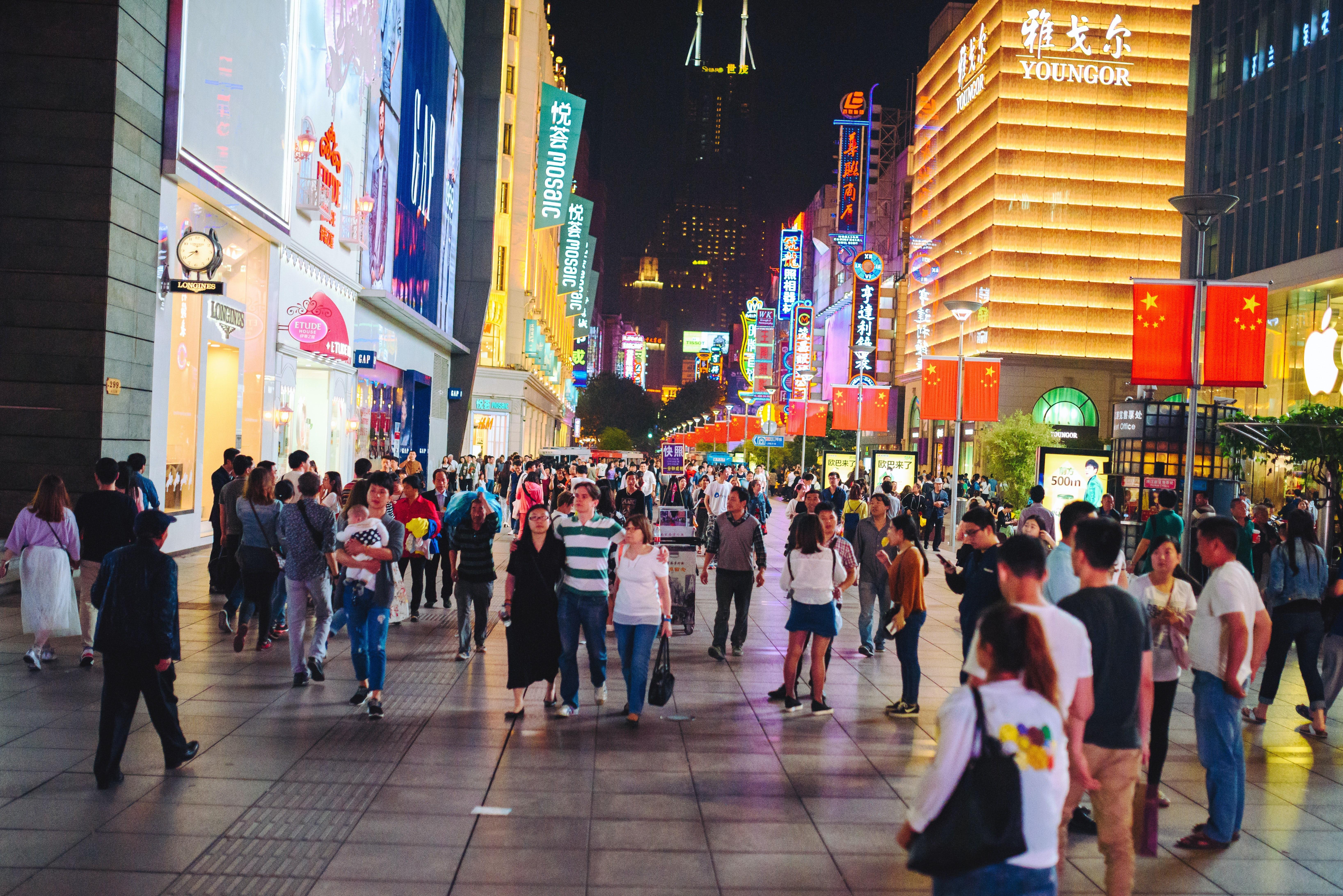 Busy shopping street in Shanghai, China. Shutterstock.