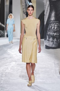 A model walks the runway in clogs from Hermès' Spring 2021 collection. Hermès.