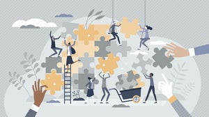 Team of employees working together. Shutterstock.