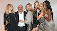 (L to R) Suki Waterhouse, Sir Philip Green, Kate Moss, Cara Delevingne, Sienna Miller and Naomi Campbell attend a 'Kate Moss for Topshop' dinner in 2014 | Source: Getty