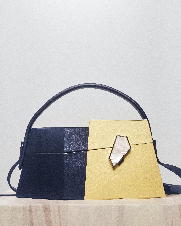 Asymmetrical bag with mother of pearl detail by Steven Ma. Casper Sejersen.
