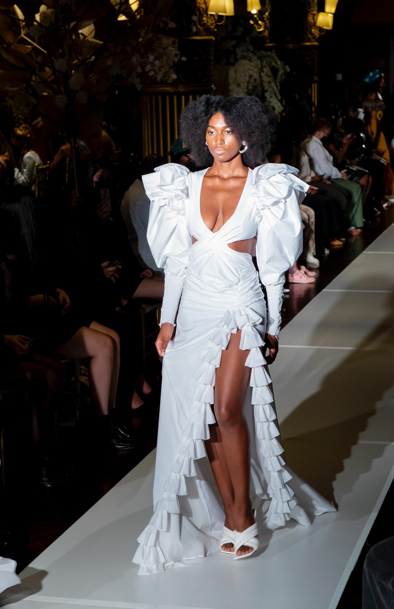 A model embodying the designers\' vision walks runway Bohn Jsell\'s Spring/Summer 2022. DiAngela Payne.
