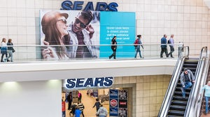 A Sears store in a mall displays its closure sign. Shutterstock.