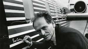 Italian-born French fashion designer Pierre Cardin signs his name on the outside of his plane in Washington, DC on September 11, 1978. Getty Images.