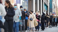 Customers queue outside a Primark store following its reopening on Oxford Street in central London. Getty Images.