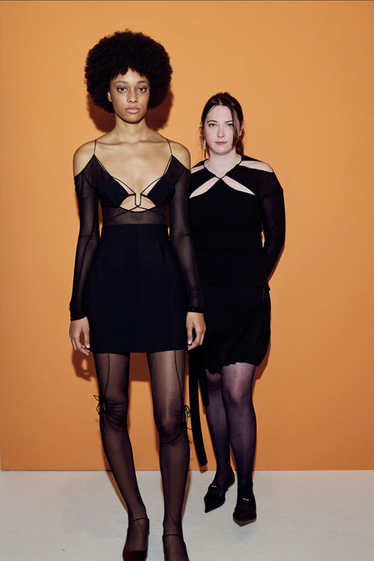 Nensi Dojaka (right) at the LVMH Prize event alongside a model sporting her Autumn/Winter 2021 collection. LVMH.