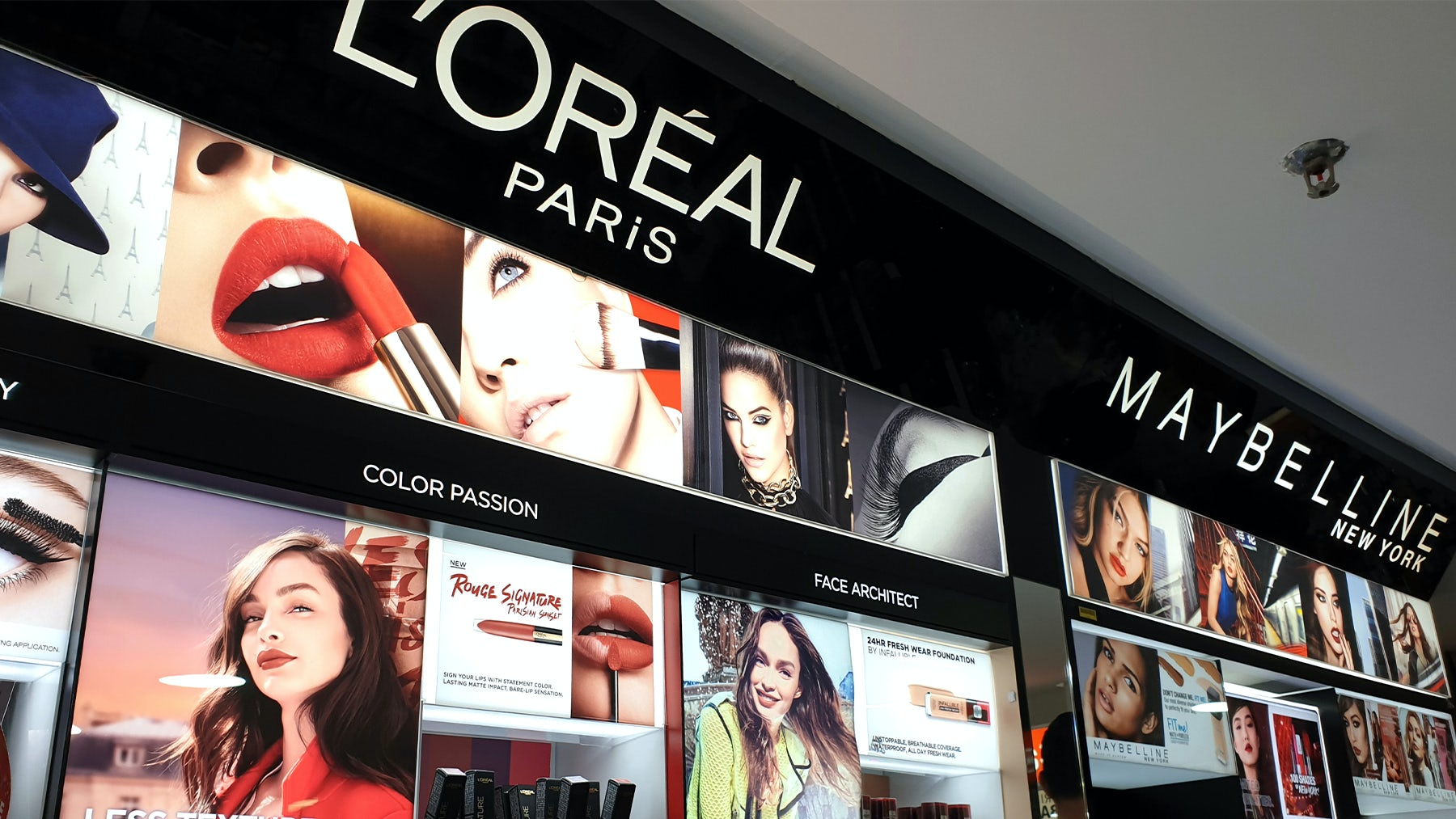 L\'Oréal and Maybelline cosmetics store in shopping mall. Shutterstock.