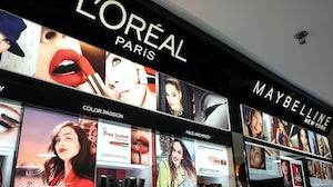 L'Oréal and Maybelline cosmetics store in shopping mall. Shutterstock.