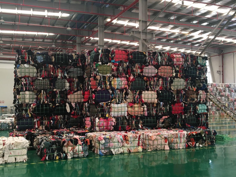 Donated clothes at a Fei Mayi warehouse. Fei Mayi