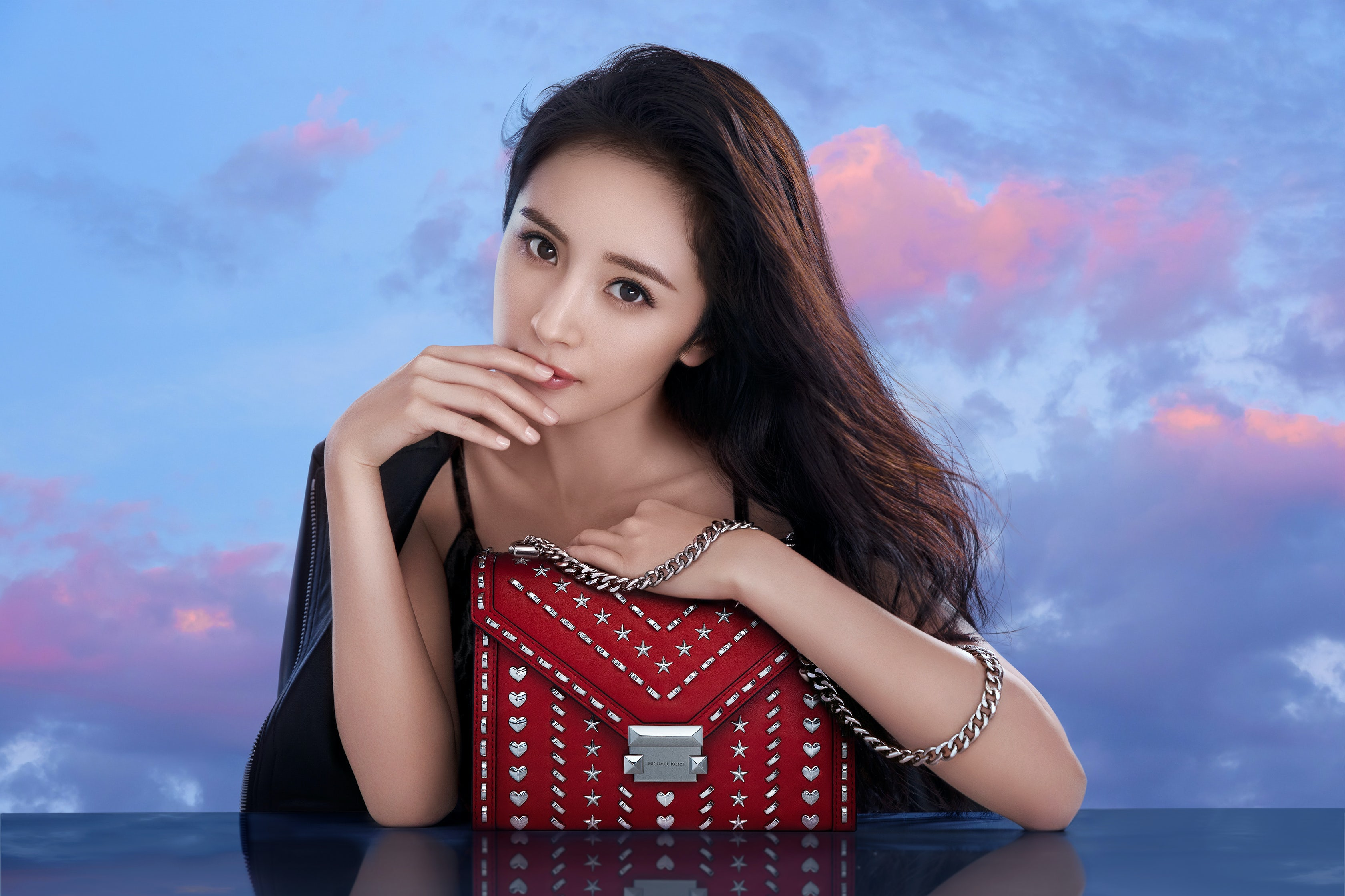 Yang Mi collaborated on a limited edition bag for Qixi in 2018 that was stocked in Michael Kors stores globally. Michael Kors.