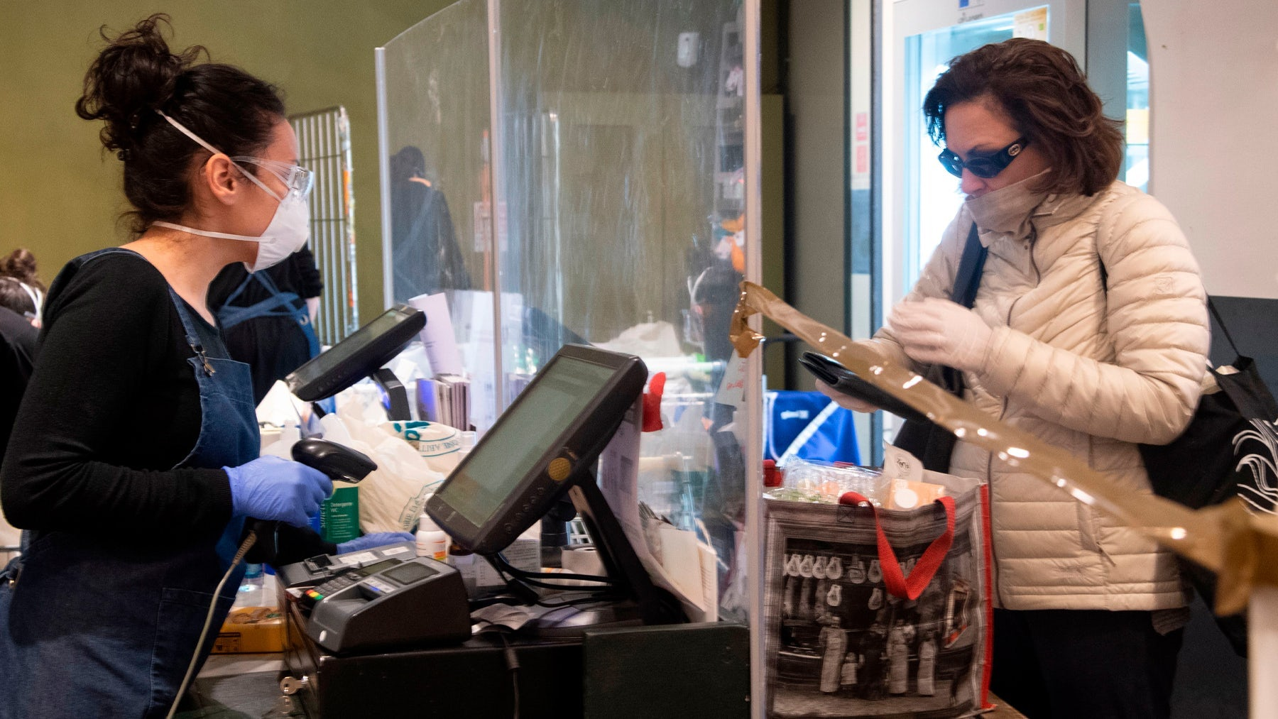 Face masks and plexiglass barriers have become the norm in shops that remain open during the Covid-19 pandemic | Source: Getty Images