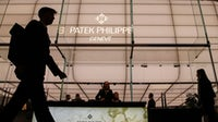 A visitor walks past a Patek Philippe SA booth during day two of the 2019 Baselworld luxury watch and jewellery fair in Basel, Switzerland. Getty Images.
