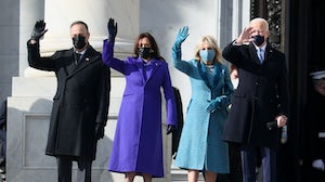 Doug Emhoff, Vice President-elect Kamala Harris, Jill Biden and President-elect Joe Biden wave as they arrive on the East Front at the inauguration. Joe Raedle/Getty Images