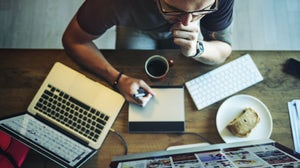 Employee working on design. Shutterstock.