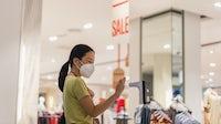A shopper wearing a mask. Shutterstock
