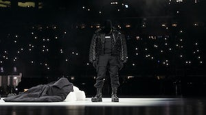 Kanye West on stage for his show in collaboration with Demna Gvasalia of Balenciaga. Courtesy.