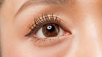 A close-up shot of a woman wearing coloured contact lenses. Shutterstock.