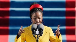 American poet Amanda Gorman reads a poem during the 59th Presidential Inauguration at the US Capitol in Washington DC. Getty Images.