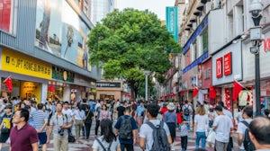 A shopping street in Wuhan, China during Golden Week in 2019. Shutterstock