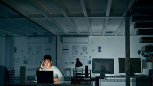 Stressed employee during a late night. Getty Images.