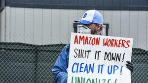 A protester outside an Amazon warehouse fulfilment centre. Stephanie Keith/Getty Images