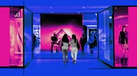 Customers enter a Louis Vuitton boutique in China. Getty Images.