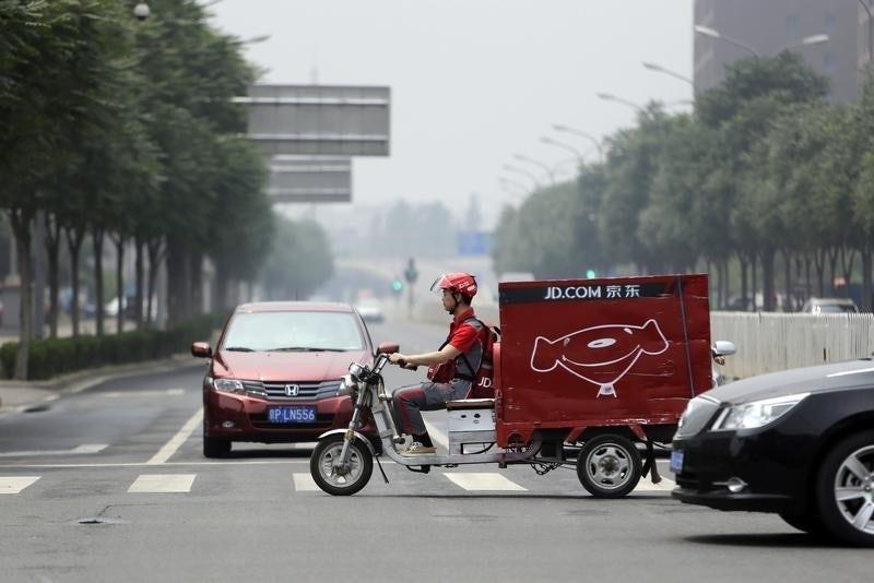 JD.com delivery. Reuters.
