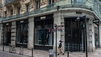 A pedestrian passes a closed Hugo Boss store during lockdown in Toulouse, France. Getty Images