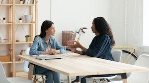 Employee Conducting An Interview. Shutterstock.