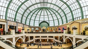 Shoppers at Mall of the Emirates, a shopping mall in the Al Barsha district of Dubai. Shutterstock.
