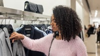 African American consumers are 31 percent more likely than the general population to spend $500 or more on a handbag, according to Nielsen surveys. Shutterstock.