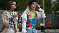 Guests attending Spring/Summer 2020 Fashion Week in Shanghai, China. Getty Images.