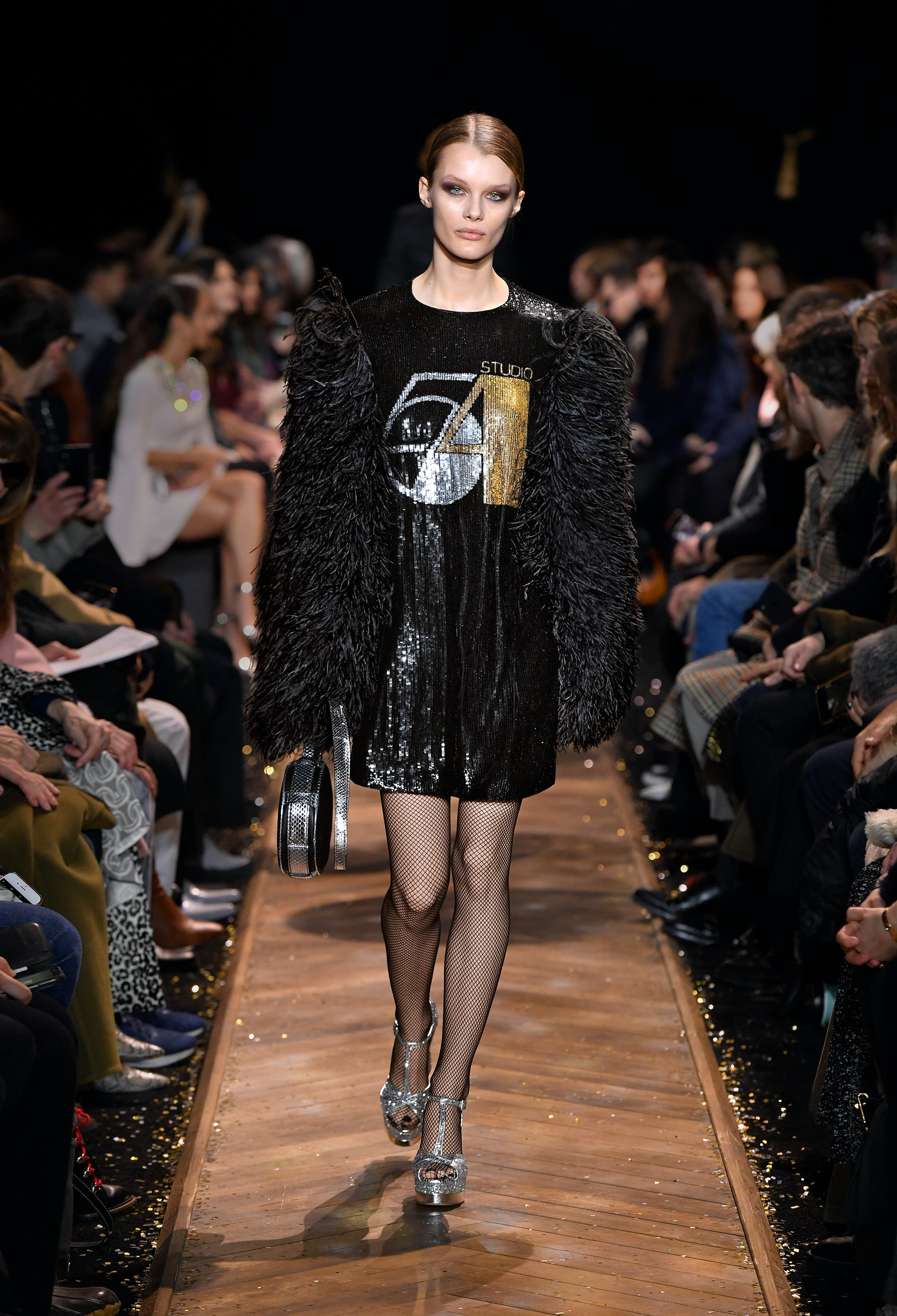 Look 65 from Michael Kors' Studio 54-themed Autumn/Winter 2019 collection worn by Kris Grikaite. Michael Kors.