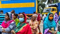 Garment workers of Binni Garments Ltd block the road at a Dhaka factory demanding payment of due wages and Eid bonus. Source: Zabed Hasnain Chowdhury/SOPA Images/LightRocket via Getty Images